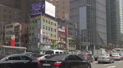 Congestion car traffic Seoul downtown people commute neon sign bustling street Stock Footage