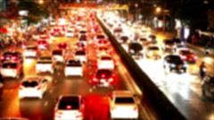 Bangkok traffic red tail lights flowing on Rama IV road time-lapse out of focus Stock Footage