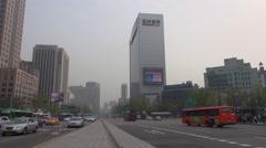 Timelapse traffic street freeway skyscraper downtown Seoul foggy day smog travel Stock Footage