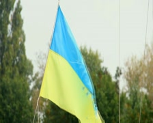 Stock Video Footage of Worn-out Ukrainian flag waving in the wind, symbol of freedom