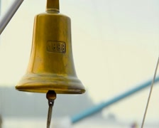 Ringing a traditional ship bell, decoration, symbol, sailing Stock Footage