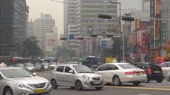 Heavy traffic street multiple lane crowded avenue Seoul people commute travel  Stock Footage