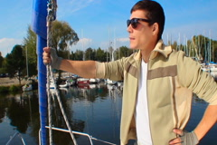 Young successful man on luxury yacht, leader, boss, millionaire - stock footage