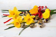 Stock Photo of Narcissus flower and quail egg