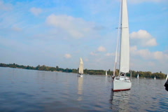 Breathtaking yachts floating on river, hobby for rich people - stock footage
