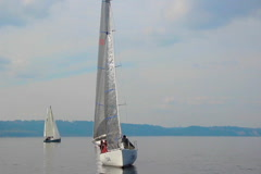 Beautiful sailing yachts in open sea, traveling, tourism, race Stock Footage