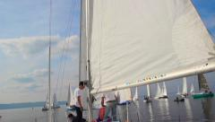 Three male sailors working on deck of yacht, teamwork, sailing Stock Footage