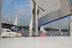 Navigating a racing yacht POV, racers line up for regatta Stock Footage