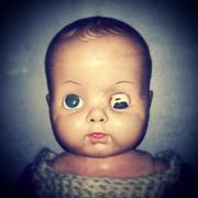 Creepy Baby Doll Stock Photos