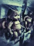 Creepy Baby Dolls in Packages Stock Photos