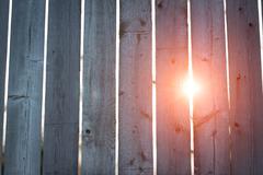 Sun Through Fence Background - stock photo