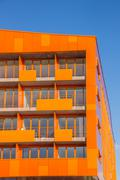 Balconies at a modern orange appartment building in Groningen - stock photo