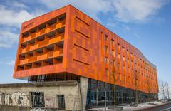 Modern orange appartment building in Groningen - stock photo
