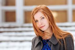 Closeup winter portrait of young beautiful redhead woman - stock photo