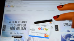 A woman with a tablet makes a purchase on ebay. - stock footage