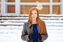 Closeup portrait of young beautiful redhead woman winter outdoors - stock photo