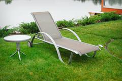 Chaise lounge on the banks of the river Stock Photos