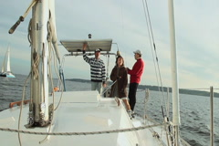 Sailing, female and male sailors working on deck of yacht Stock Footage