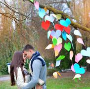 Young woman and man in the decoration of the heart, on the feast of St. Valen Stock Photos