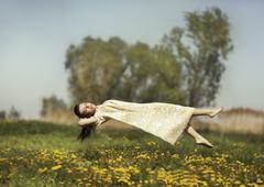 Levitation girls over the field. Stock Photos