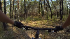 Mountain biking through bush - stock footage