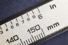 Millimeters and Inches - stock photo