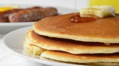 Pouring syrup on pancakes Stock Footage