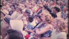1715 - audience listens to speaker at outdoor theater - vintage film home movie Stock Footage