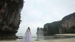 blonde girl demonstrates her wedding dress - stock footage