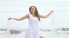 blonde bride in wedding dress wave with white veil - stock footage