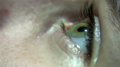 4K Close-up of green female eye blink and iris focusing. UHD stock video - stock footage