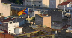 Sunset flag waving on city building 4k caldes d'estrac spain Stock Footage