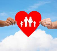 Couple hands holding red heart with family Stock Photos