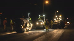 Workers repairing a road at night Stock Footage