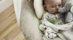Newborn boy sleeping in swing Stock Footage