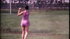1711 - girls at golf driving range hitting balls - vintage film home movie Stock Footage