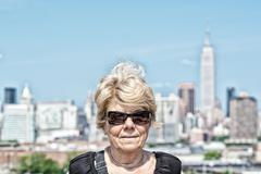 Caucasian tourist female in 60s visiting New York City on a sunny day - stock photo