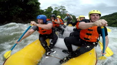 Level IV whitewater rafting splashed by three huge waves slow motion 120fps, on Stock Footage