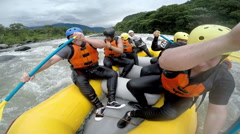 Group of seven people paddling hard on Pastaza river Ecuador, onboard off axis Stock Footage
