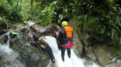 Adult men get punched and falls into waterfall during canyoning trip, a joke of Stock Footage