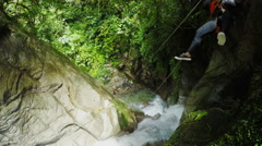 Zip line over waterfall in Llanganates national park canyoning expedition, Stock Footage