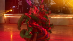 Two girls in cabaret costumes dance cancan Stock Footage