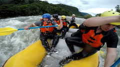 Group of seven people screaming and yelling on whitewater rafting trip, on board Arkistovideo