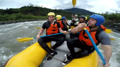 Team of seven people whitewater rafting slow motion converted from 120fps with Stock Footage