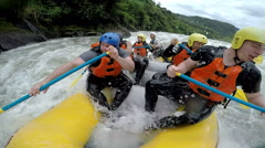 Whitewater rafting funny moment when an oversized men almost felt out of the Stock Footage