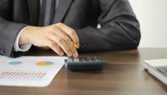 Close-up of checking financial results  Stock Footage