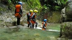 Family canyoning expedition, static camera, Llanganates national park, Ecuador Stock Footage