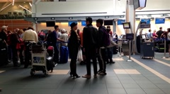 Passangers long line up for waiting check in counter at YVR airport - stock footage