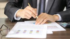 Close-up of checking financial results  - stock footage