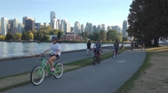 People riding bicycle in the Stanley park Stock Footage